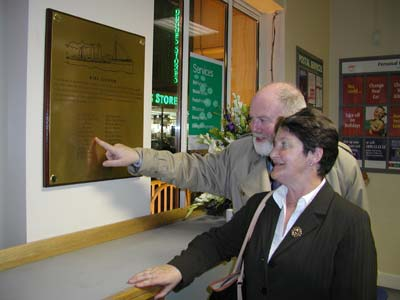 Philip Lecane pointing out to Marie Comiskey the name of her relative, Postal Sorter Matthew Brophy.