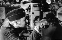 Crew looking through the periscope of a U-boat